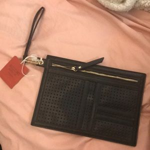 NWT slim black hand bag